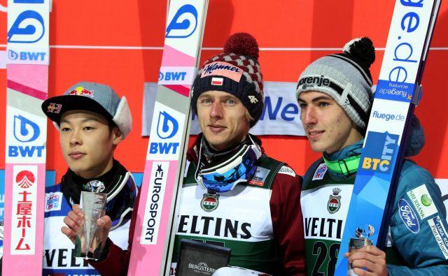 Zmagovalna trojica. FOTO: Wolfgang Rattay/Reuters