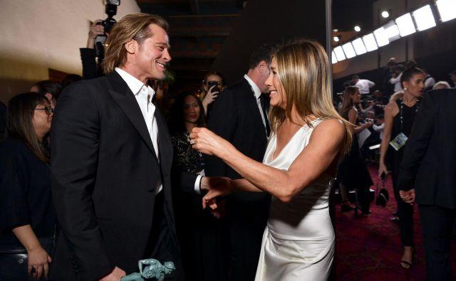 Brad in Jennifer sta ostala prijatelja, njuni stiki pa so menda po Pittovi ločitvi od Angeline Jolie še tesnejši. FOTO: Emma Mcintyre/AFP