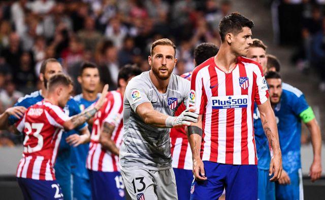 Jan Oblak bo čuval vrata Atletica, Alvaro Morata bo napadal vrata svojega nekdanjega kluba Reala. FOTO: AFP