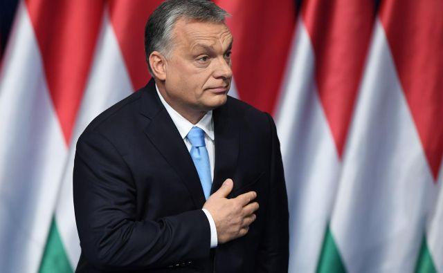 Stranka Fidesz Viktorja Orbánavsaj za leto dni ostaja članica Evropske ljudske stranke. FOTO: Attila Kisbenedek/AFP