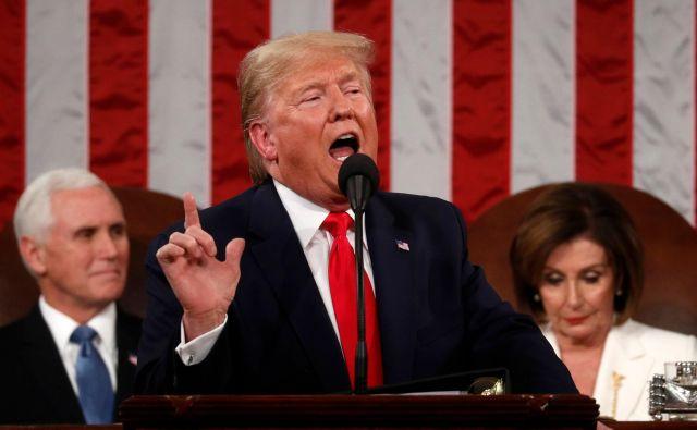 Predsednik Donald Trump med nastopom v kongresu. FOTO: Leah Millis/AFP