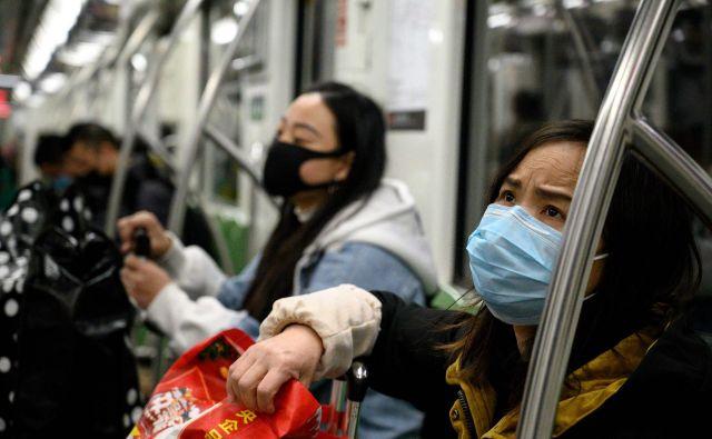 Po podaljšanih praznikih ob kitajskem novem letu se bodo prihajajoči teden ljudje začeli vračati na delo. FOTO: Noel Celis/Afp