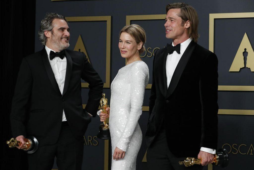 FOTO:Parazit pometel s konkurenco, med igralci slavila Joaquin Phoenix in Renee Zellweger
