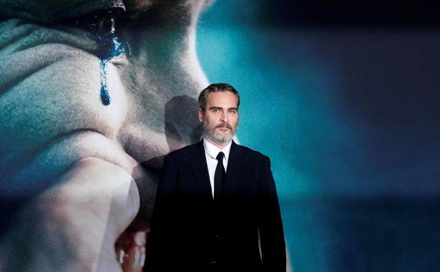 Joaquin Phoenix: Naredili smo film o fiktivnem liku v fiktivnem svetu, in upaš, da ga bodo ljudje videli takšnega, kot je. Ne moremo vendar kriviti filma za svet, ki je tako zjeban, da lahko karkoli sproži nasilje. FOTO: Mario Anzuoni Reuters