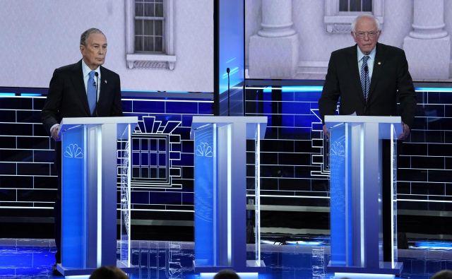Nekdanji župan New Yorka Mike Bloomberg in vermontski senator Bernie Sanders med televizijskim soočenjem v Las Vegasu Foto Reuters