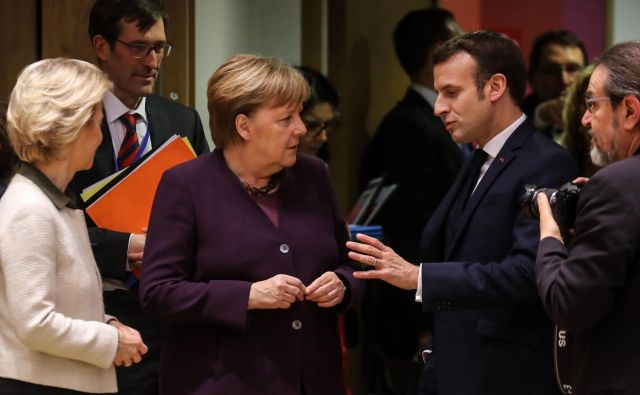 FOTO: Nemška kanclerka <strong>Angela Merkel</strong> in francoski predsednik <strong>Emmanuel Macron </strong>sta vzela vajeti vrha v svoje roke. FOTO: Ludovic Marin/AFP