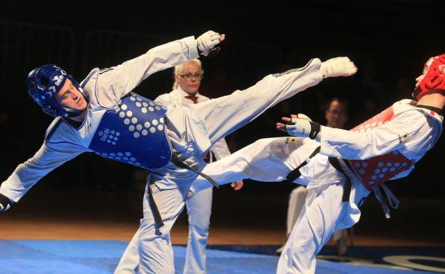 Ivan Trajković (v modrem) je dobre volje vstopil v leto, v katerem bodo vrhunec olimpijske igre v Tokiu. FOTO: Tadej Regent