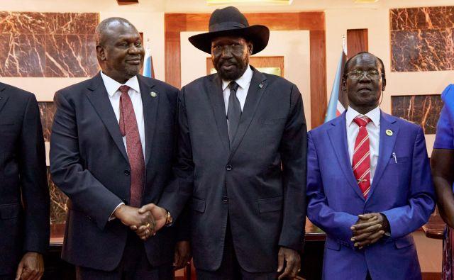 Riek Machar in Salva Kiir sta po šestih letih vojne ponovno oblikovala skupno vlado. FOTO: Alex Mcbride/AFP