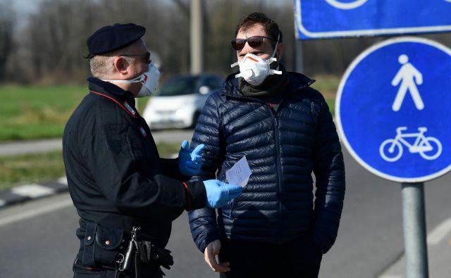 Novi koronavirus je v Italiji doslej zahteval pet življenj. FOTO: Miguel Medina/AFP
