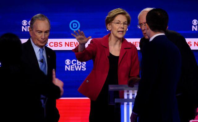 Mike Bloomberg, Elizabeth Warren in Bernie Sanders po televizijskem soočenju. FOTO: Jim Watson/AFP