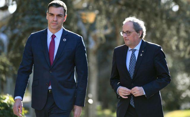 Včeraj sta se v prestolnici sestala katalonski predsednik Quim Torra in španski premier Pedro Sánchez. Foto: AFP