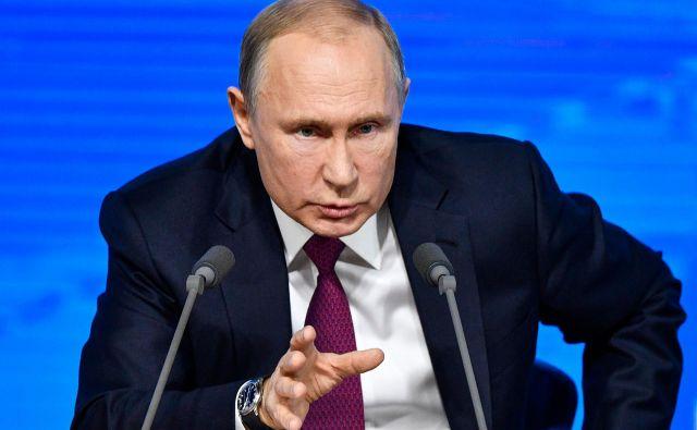 Ruski predsednik Vladimir Putin želi vpis vere Rusov v Boga in heteroseksulnega zakona v ustavo. FOTO: Alexander Nemenov/AFP