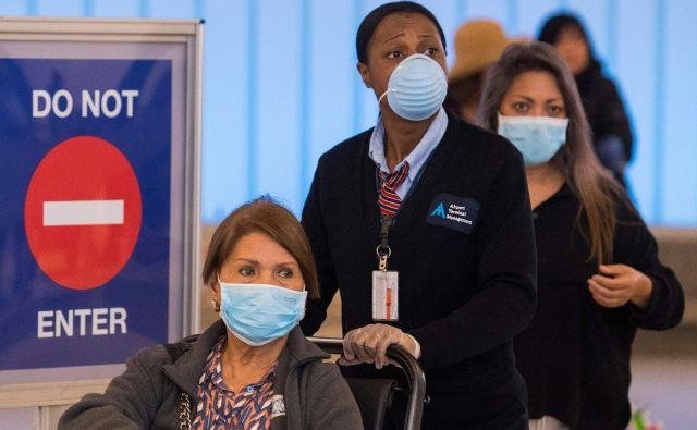 Število okuženih s koronvairusom in držav s primeri okužbe je danes strmo naraslo. FOTO: Mark Ralston/Afp