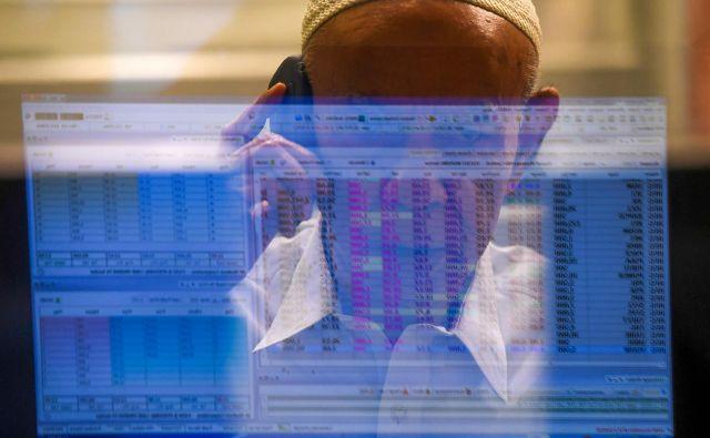 Finančni trgi so v pričakovanju spodbud, ki jih bo predvidoma popoldne razkril ameriški predsednik Donald Trump. FOTO: Asif Hassan / AFP