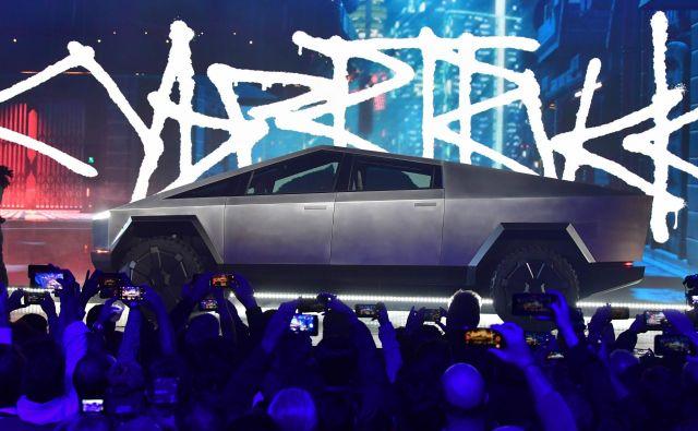 Tesla je paradni konj ameriške avtomobilske industrije in njen uspeh bi lahko naznanil selitev središča ameriške avtomobilske industrije iz Michigana v Kalifornijo. FOTO:AFP