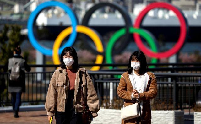 Na Japonskem si še vedno mnogi želijo, da bi v poletju izvedli olimpijske igre. FOTO: Reuters
