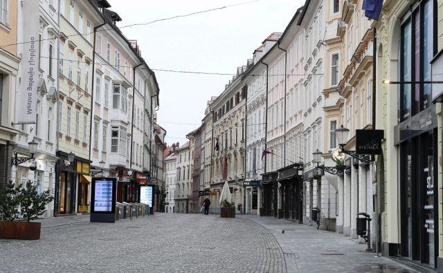 Prazne ulice v Ljubljani dokazujejo, da ljudje večinoma spoštujejo odlok. FOTO: Marko Feist