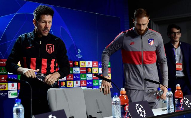 Atleticov trener Diego Simeone in vratar Jan Oblak. FOTO: AFP