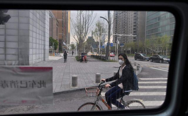 V kitajskem Wuhanu so po dveh mesecih spet odprli prometne povezave. FOTO: Hector Retamal/Afp