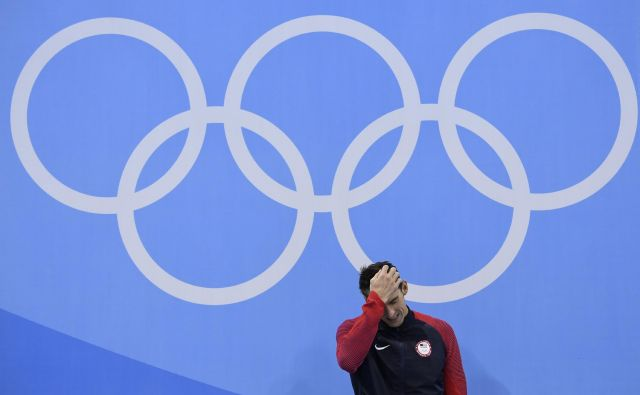 Michael Phelps je s fantastičnimi uspehi postal ikona petih olimpijskih krogov, a plačal visoko ceno. FOTO: AFP
