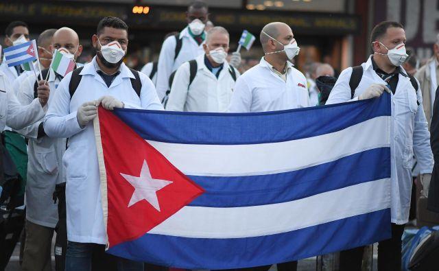 Pomoč kubanskih zdravnikov Italiji FOTO: Reuters
