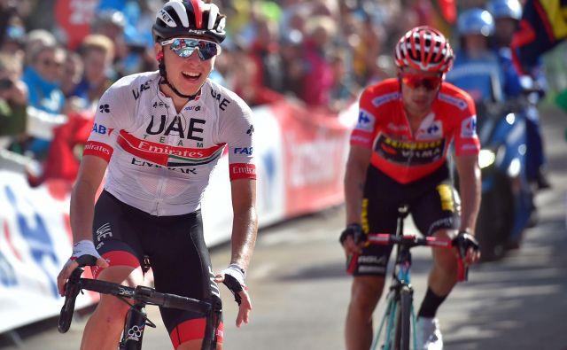 Tadej Pogačar (levo) in Primož Roglič (desno) sta si veliko obetala od letošnjega Toura. FOTO: AFP