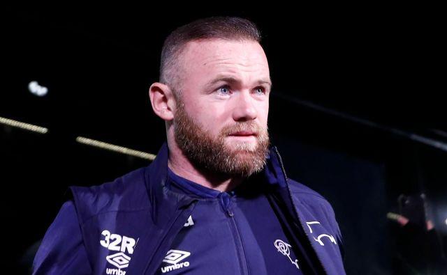 Wayne Rooney se je postavil v bran angleškim nogometašem. FOTO: AFP