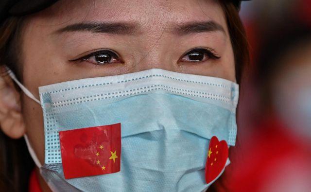 Veselimo se z Wuhanom, da je za njegove prebivalce najhuje minilo. FOTO: AFP