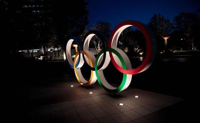 Epidemija koronavirusa je tudi japonske prireditelje olimpijskih iger tako prestrašila, da si ne upajo zagotovoti, da bodo naslednje leto izpeljali največje športno tekmovanje. FOTO: AFP
