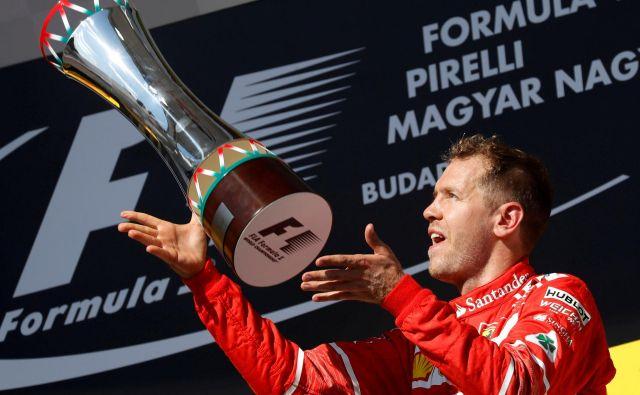 Sebastian Vettel si želi, da bi se v prihodnje pri Ferrariju še tako veselil, kot se je pred tremi leti po zmagi v Budimpešti. FOTO: Reuters