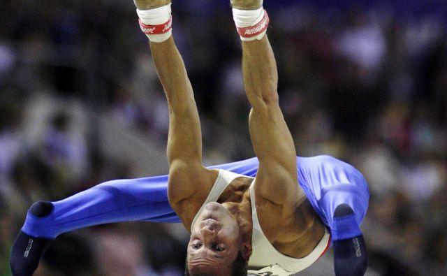 Aljaz Pegan je v športni gimanstiki vztrajal kar 33 let. Najbolje se je počutil na drogu. FOTO: Reuters