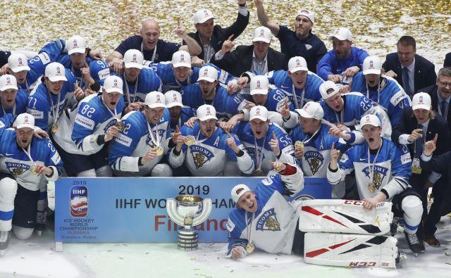 Na lanskem SP so naslov prvaka slavili finski hokejisti. FOTO: Reuters