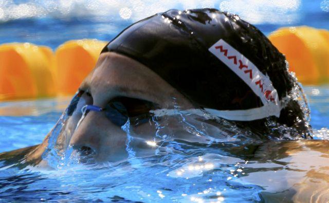 Najboljši plavalci in plavalke se bodo za kolajne na svetovnem prvenstvu v Fukuoki potegovali šele leta 2022. FOTO: Reuters