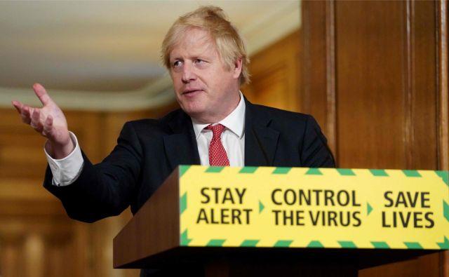 Britanski premier Boris Johson je v nedeljo predstavil izhodno stretegijo, s katero namerava postopno popeljati državo v normalnost. Foto: AFP
