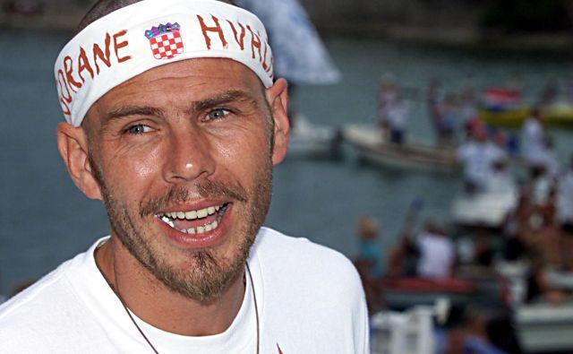 <strong>Zvonimir Boban</strong> nikdar ni skrival patriotizma. Tako vzhičeno je pričakoval <strong>Gorana Ivaniševića</strong> na sprejemu v Splitu, julija 2001, potem ko je slednji osvojil sloviti wimbledonski teniški turnir. FOTO: Reuters