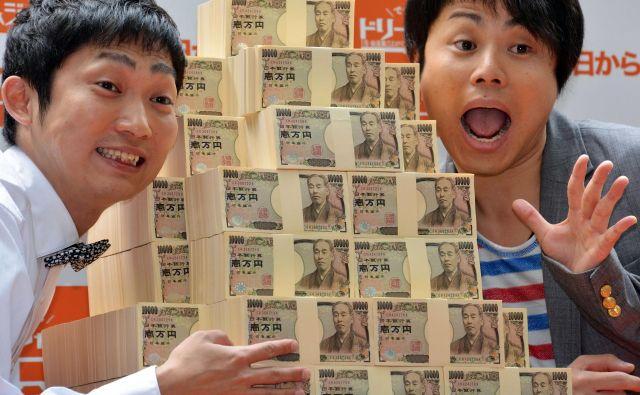 Igre v Tokiu bodo zaradi preložitve še precej dražje.FOTO: AFP