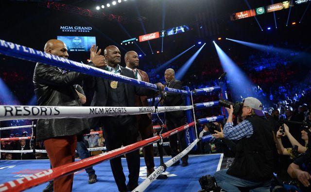 Stara znanca Mike Tyson (levo) in Evander Holyfield sta se zavzela za še tretji dvoboj, ki pa bo dobrodelen. FOTO: USA Today Sports