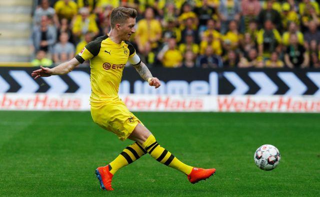 Dortmund ostaja v boju za nemški vrh, pa četudi igra brez svojega kapetana Marca Reusa. FOTO: Reuters