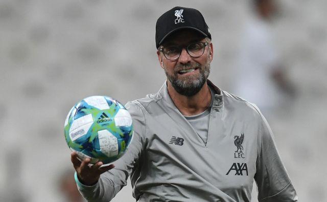 Jürgen Klopp je ob vrnitvi svojih nogometašev na skupinske treninge dejal, da igralcev ne namerava ogrožati ali jih postavljati v položaje, ki bi bili zdravstveno tvegani. FOTO: AFP