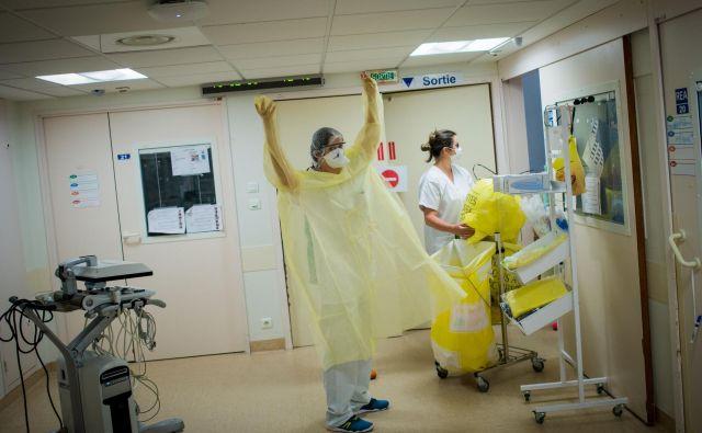 V Sloveniji ni bilo potrejnih novih okužb in smrti, nekja ljudi je še vendo na intenzivni negi. FOTO: Loic Venance/Afp