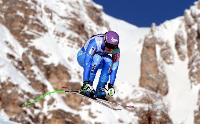 Italijansko smučarsko središče Cortina d'Ampezzo je bilo tudi prizorišče svetovnega pokala, kjer je z nasmehom tekmovala slovenska alpska smučarka Tina Maze. Z zmago na januarskem smuku leta 2014 je napovedala olimpijsko zlato v Sočiju. FOTO: AFP