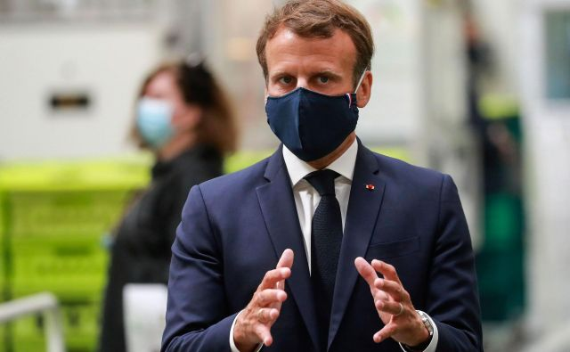 Predsednik Emmanuel Macron rešuje avtomobilsko industrijo. Foto AFP