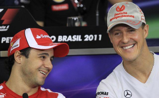 Felipe Massa (levo) močno upa, da se bo Michael Schumacher nekega lepega dne spet pojavil na dirkališču. FOTO: Reuters