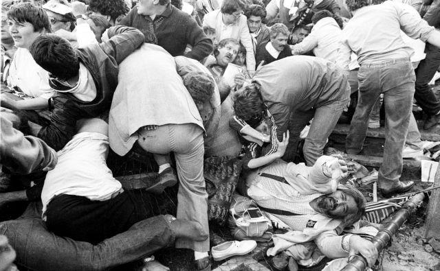 Po divjanju huliganov, večinoma angleških, je življenje pred tekmo Liverpoola in Juventusa izgubilo 39 ljudi. FOTO: Reuters