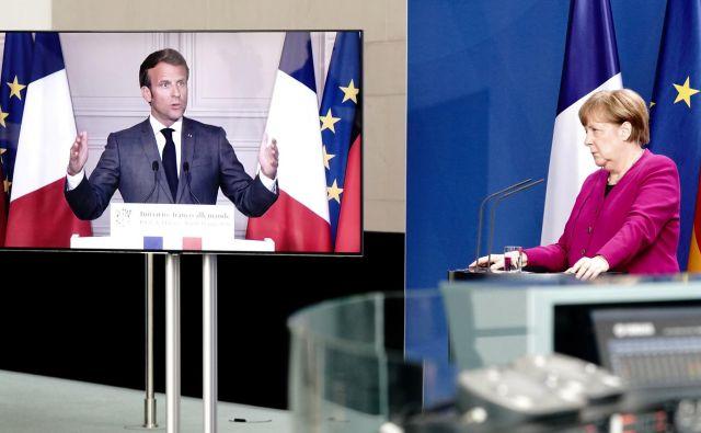 Nemška kanclerka Angela Merkel in francoski predsednik Emmanuel Macron sta odločno za podporo evropskemu gospodarstvu. FOTO: Kay Nietfeld/Reuters
