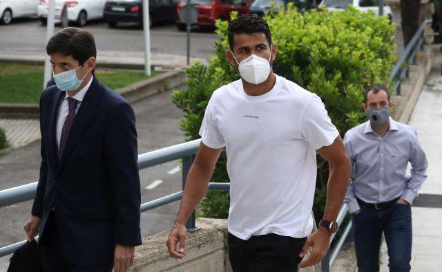 Diego Costa (desno) se je s špansko davčno upravo poravnal in se izognil zaporni kazni. FOTO: Reuters
