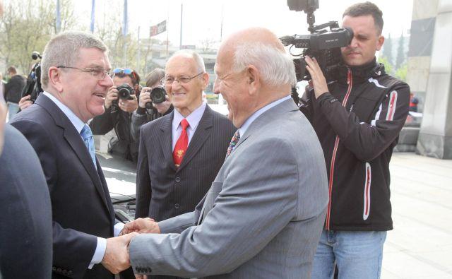 Predsednik Moka Thomas Bach (levo) je izjemno cenil Janeza Kocijančiča (desno), v sredini Miroslav Cerar. FOTO: Marko Feist