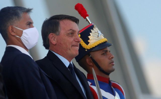 Predsednik Brazilije Jair Bolsonaro grozi, da bo Brazilija sledila zgeldu ZDA in izstopila iz WHO. FOTO: Adriano Machado/Reuters