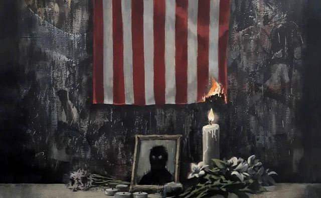 Sveča, ki na Banksyjevi podobi gori v poklon Georgeu Floydu, z ognjem načenja tudi simbol ZDA, državno zastavo. FOTO: @banksy Instagram/Reuters