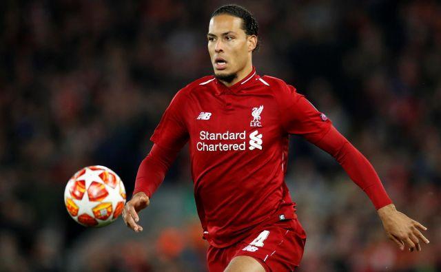 Pred enim letom so se lovorike v ligi prvakov veselili nogometaši Liverpoola, med katerimi je bil eden glavnih adutov Virgil van Dijk. FOTO: Reuters